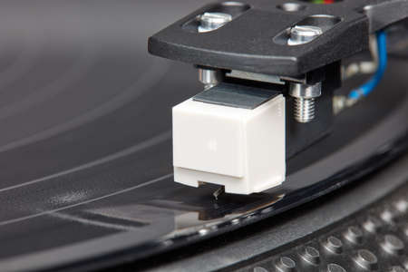 Detail shot of a turntable for the retro experience of listening to music.