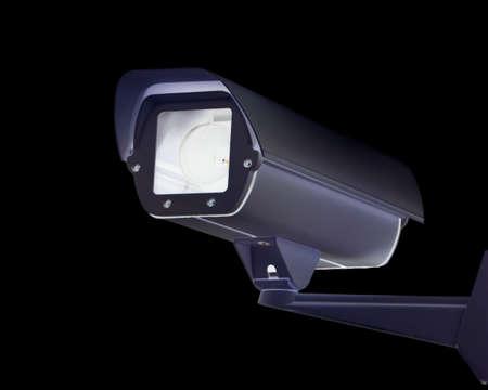 A new security camera against a black background. 版權商用圖片