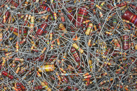 Many old colored resistors with wire terminals.