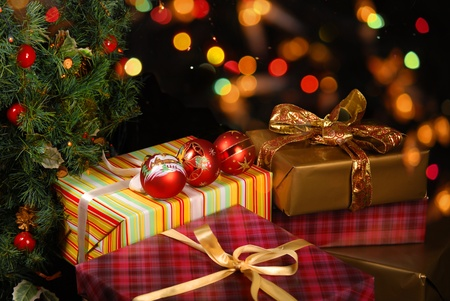 Gifts Under The Christmas Tree Lights Background Stock Photo ...