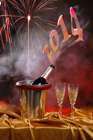 pouring champagne and fireworks on a dark background photo