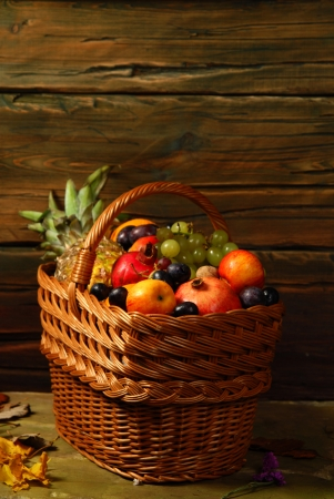 Basket with different fruits on the background    photo