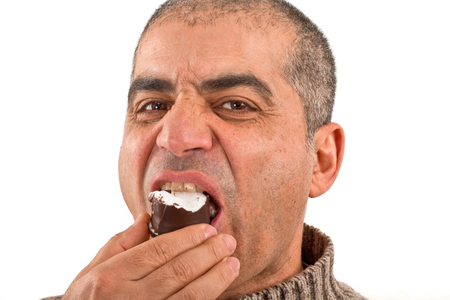 nibble: arab eating a chocolate marshmallow Stock Photo