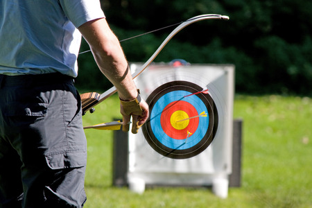 Archer by the aim shooting
