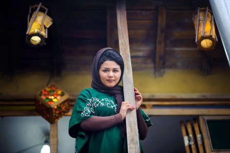The beautiful, young Iranian with a gentle smile looks in the camera