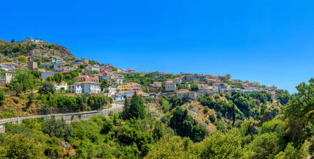 the small Albanian city through which the road runs, located on the mountain overgrown with the wood