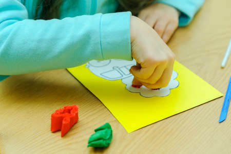 Children at a lesson of the fine arts, are engaged in application and a rusovaniye, rusut and decorate on contours, I paste strips of color paper, prepare gifts for holidays