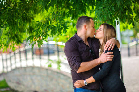 gently: husband gently embraces the wife, are kissed gently