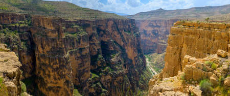 toroweap: Huge break of crust in the Iranian mountains, orange steep slopes of big height, the blue sky