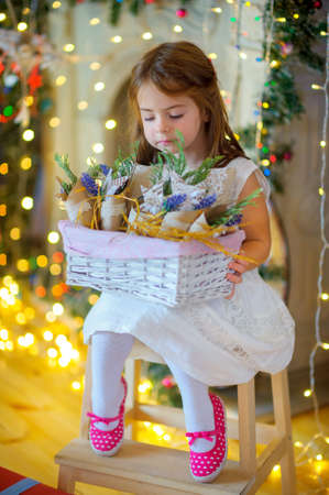 girl considers Christmas jewelry, a set of bright sparks at a background