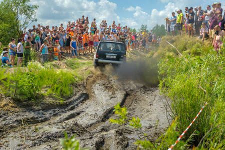 Belarus, Brest, 2016 - off-road competitions, the SUV overcomes an obstacle, a set of dirt Editorial