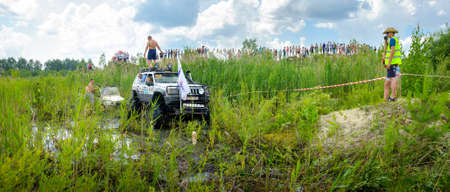 Belarus, Brest, 2016 - off-road competitions, a set of various SUVs, beautiful clouds in the sky Editorial