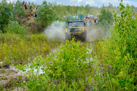 truck driver: Belarus, Brest, 2016 - off-road competitions, the SUV overcomes an obstacle, a set of splashes