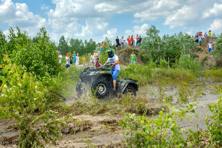 truck driver: Belarus, Brest, 2016 - off-road competitions, the ATV overcomes a water obstacle, a set of splashes