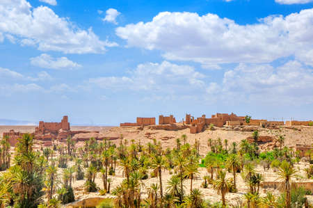 old clay villages of Morocco the located on border with the desert of sugar, palm oases