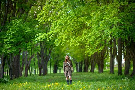 woman in the uniform of the military in the beautiful spring park