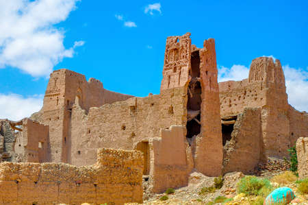 abandoned and destroyed settlements in a desert part of Morocco, mud houses of bright saturated color