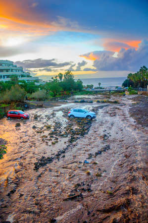 natural cataclysm, mountain flow washed away the automobile parking, two-cars got got stuck in dirt Reklamní fotografie - 89879576