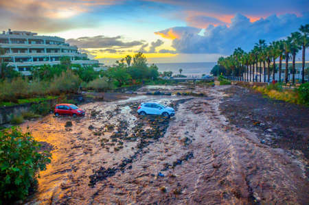 natural cataclysm, mountain flow washed away the automobile parking, two-cars got got stuck in dirt Reklamní fotografie