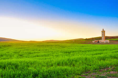 abandoned mosque in the Moroccan province on a sunset Stock Photo