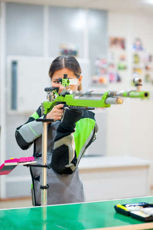 girl concentrates aiming at the competitions in the field Banco de Imagens - 88942076