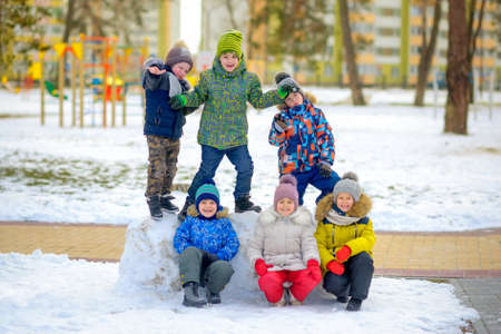 funny friends play at the winter playground