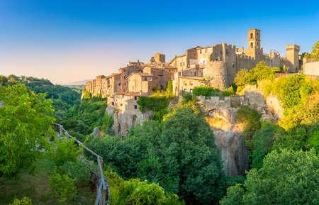 Panorama of the medieval town of Viturchiano located on the edge of the cliff, at sunset, Lazio. Italy. Europe Stock Photo