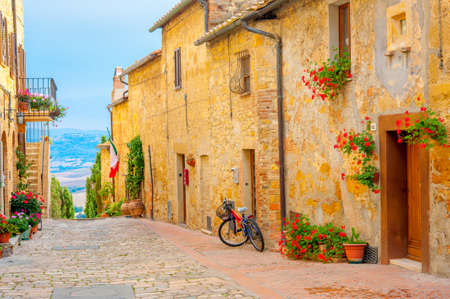 A street in the beautiful little village of San Gimignano with a view of the Tuscan valley. Italy. Europe Stok Fotoğraf