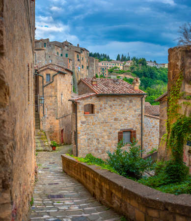 Beautiful evening street in the old medieval town in Tuscany. Sorano. Italy