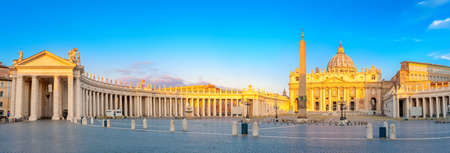 Panorama of St. Peters Square illuminated by the first rays of the morning sun, the Vatican. Italy
