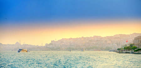 view from the Bosphorus Strait to the city of Istanbul at sunset, a lot of pleasure craft with tourists