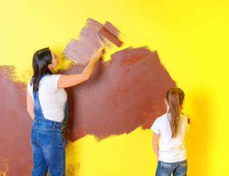 mother and daughter will brighten the wall with rollers, repairs in the room