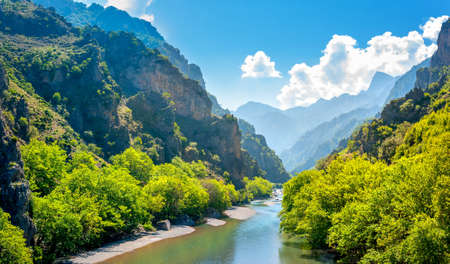 Panorama of the mountains in Greece in the area Zagori, the river flowing in the canyon