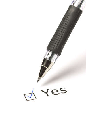 Vote Yes! Closeup of pen and yes-option on white background photo