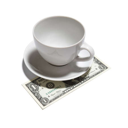 tax tips: One dollar tip - closeup of one dollar, tea cup and saucer isolated on white background