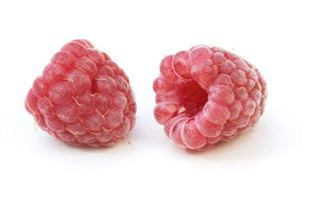 Closeup of two raspberries isolated on white background with light shadow photo
