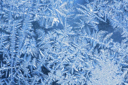 hoar: Hoarfrost - the patterns made by the frost on the window (hoarfrost background) Stock Photo