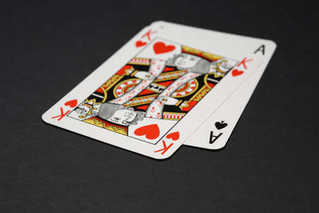 Blackjack - closeup of two playing cards: king and ace. Shallow focus depth on front sides of cards