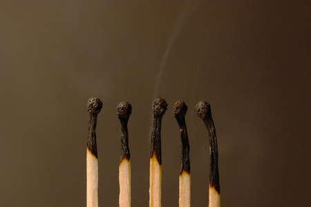 extinction: Five matches on dark background - extinction (setmatches)