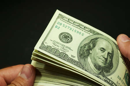 Cash counting - US dollars Stock Photo - 5586271