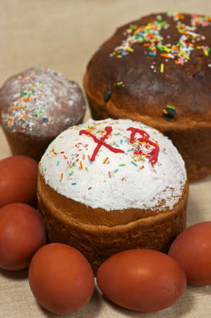 paschal: Closeup of Easter cake and paschal eggs. Focus depth on the front cake and eggs Stock Photo