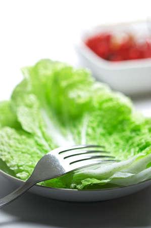 Very simple salad. Shallow dof with focus on the fork Zdjęcie Seryjne