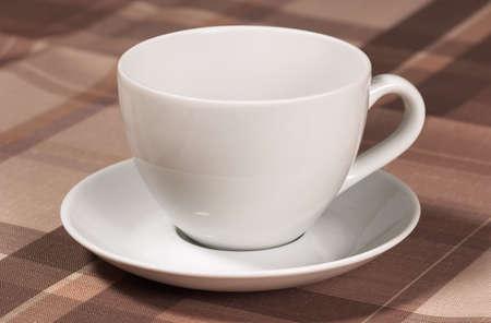 Closeup of teacup on table-cloth