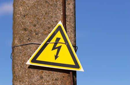 High voltage sign on lamppost and blue sky Zdjęcie Seryjne