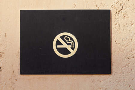 Closeup of no smoking sign warning board on wall