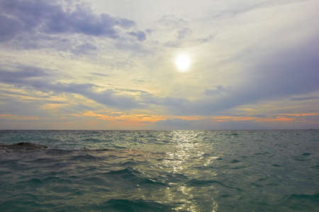 Sea ocean landscape - water waves, sun, clouds sky. Thailand