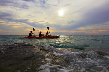People traveling in boat - Sea landscape waves, sun, sky. Thailand. Faces are blured.