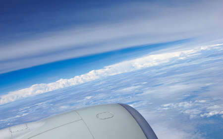 Clouds blue sky and reaction turbine - view from airliner photo