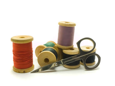 needlewoman: An isolated colourful photo of several threads and scissors Stock Photo