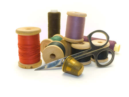 An isolated colourful photo of several threads and scissors photo